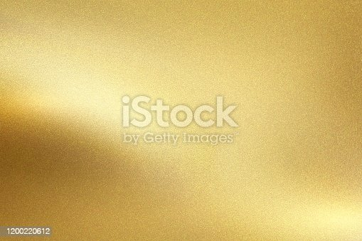 istock Gold foil metal wall with glowing shiny light, abstract texture background 1200220612