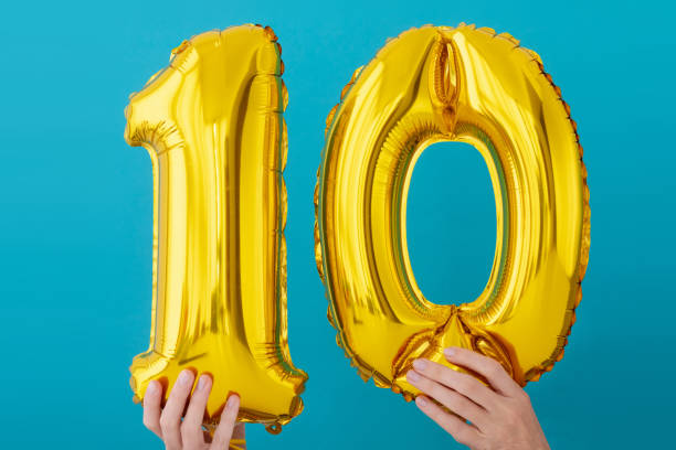 Gold foil number 10 ten celebration balloon stock photo