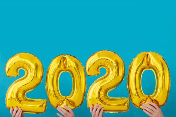 Gold foil number 2020 celebration balloon stock photo