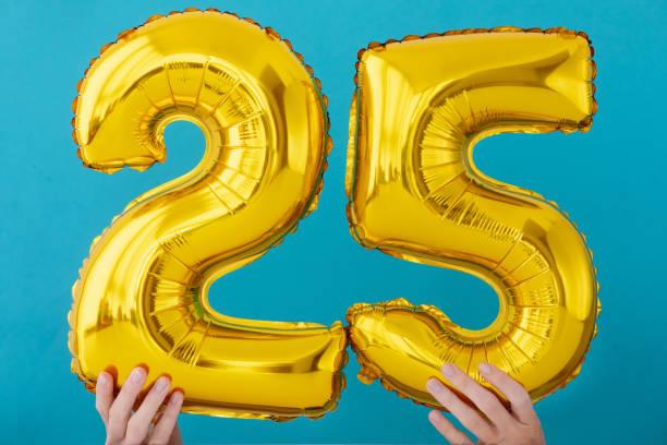 Gold foil number 25 twenty five celebration balloon stock photo