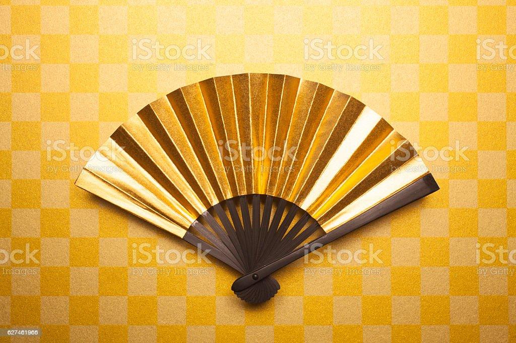 Gold folding fan stock photo