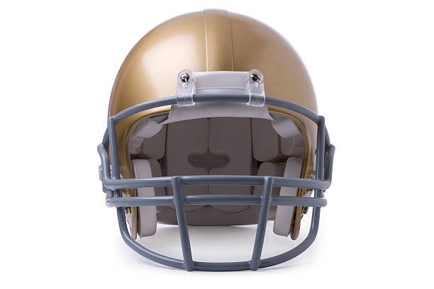 Gold football helmet isolated on white Gold football helmet isolated in front view football helmet stock pictures, royalty-free photos & images