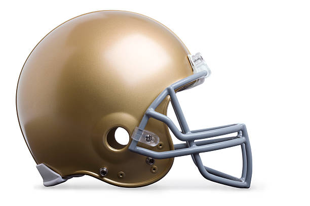 Gold football helmet isolated profile view Gold football helmet isolated on white in profile viewSome others you may also like: football helmet stock pictures, royalty-free photos & images