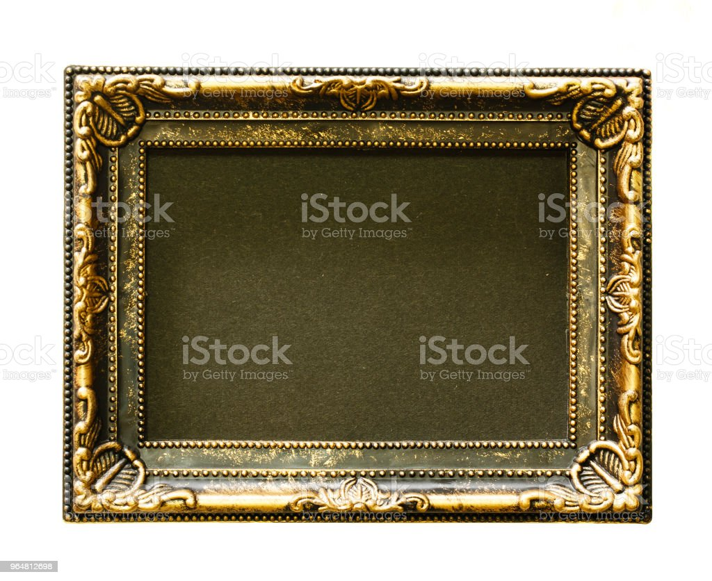 Gold frame. Gold/gilded arts and crafts pattern picture frame. Isolated on white. space is black. royalty-free stock photo