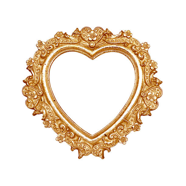 A gold frame in the shape of a heart stock photo
