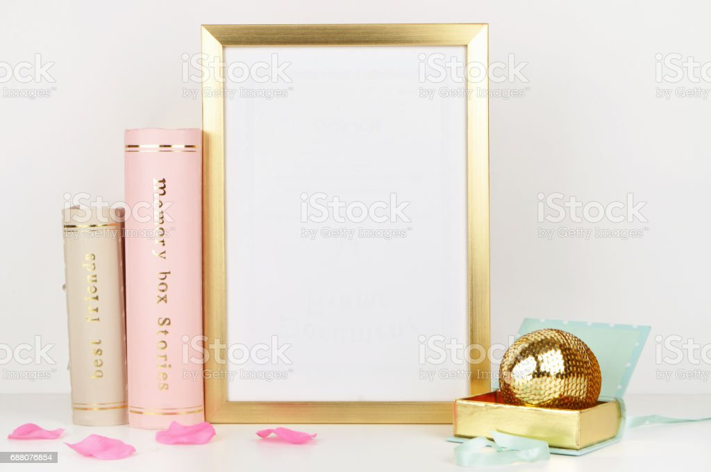 Gold Frame Mockup And White Wall With Gold Book And Woman Things