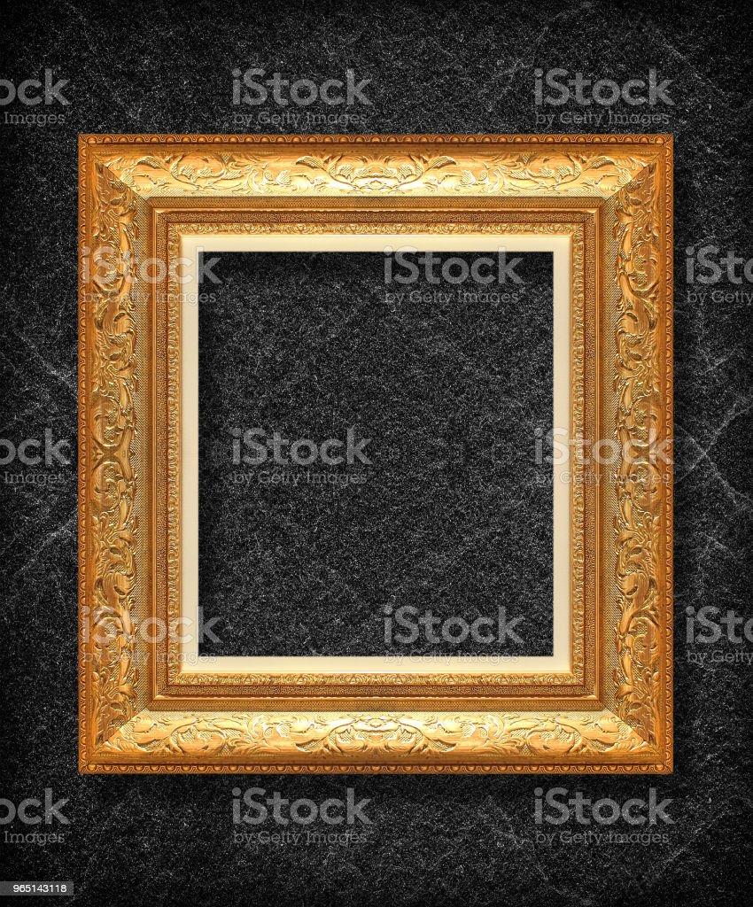 gold frame on black slate background zbiór zdjęć royalty-free