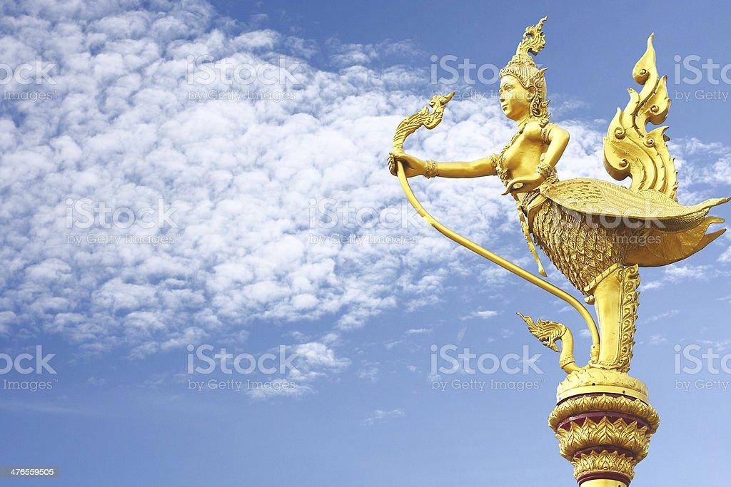 Gold Garuda statue in the sky stock photo