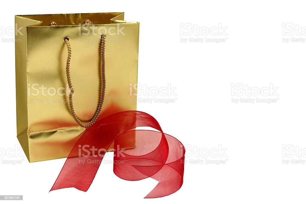 Gold gift bag royalty-free stock photo