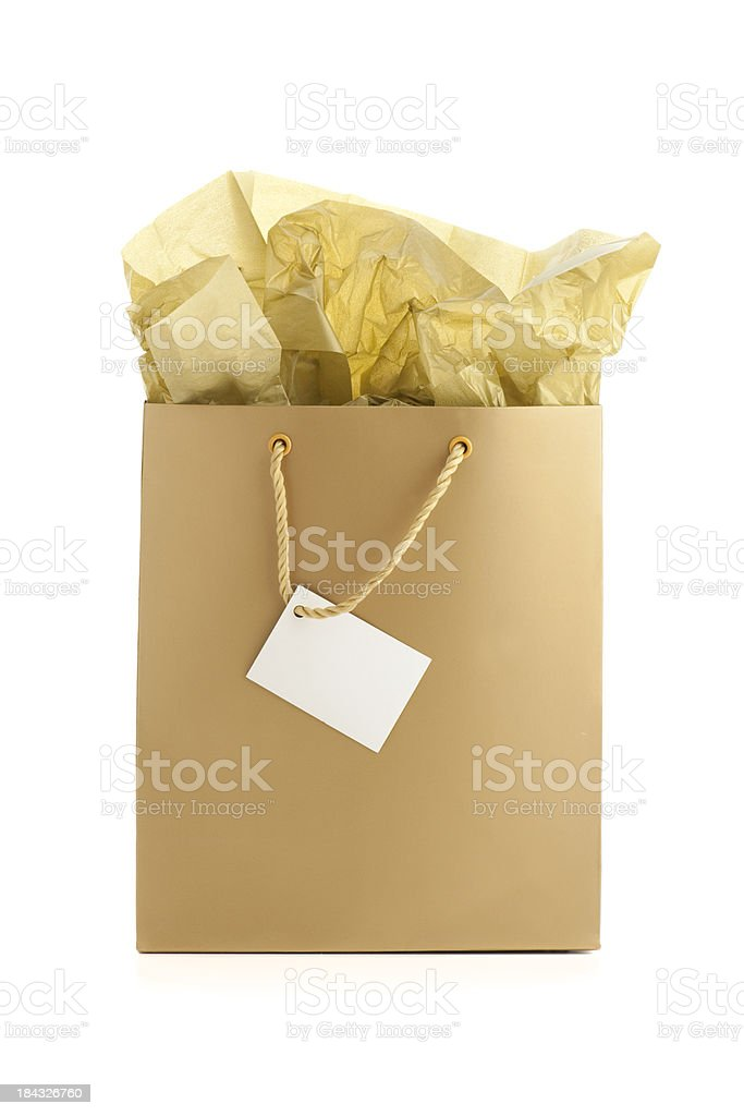 Gold gift bag with tissue and blank giftcard stock photo