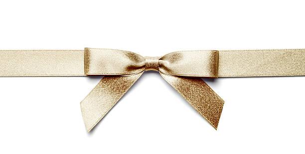 gold geschenk bogen und band isoliert mit clipping path - geschenkschleife stock-fotos und bilder