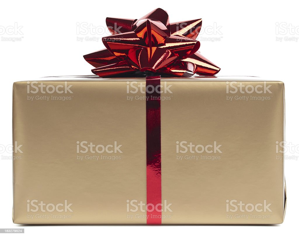 Gold gift box rapped in red ribbon stock photo