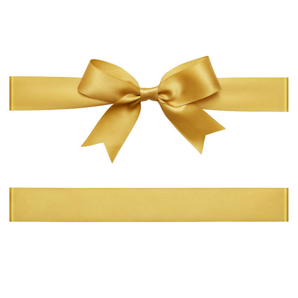 gold gift ribbon tied in a bow on white background, cut out top view - ribbon sewing item stock photos and pictures