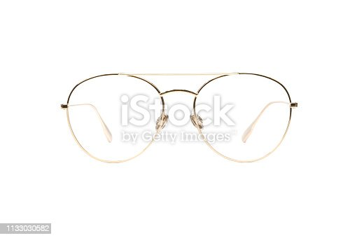 1047544590 istock photo Gold glasses metal in round frame transparent for reading or good eye sight, front view isolated on white background 1133030582