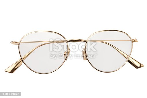 1047544590 istock photo Gold glasses metal in round frame transparent for reading or good eye sight, top view isolated on white background 1133030612