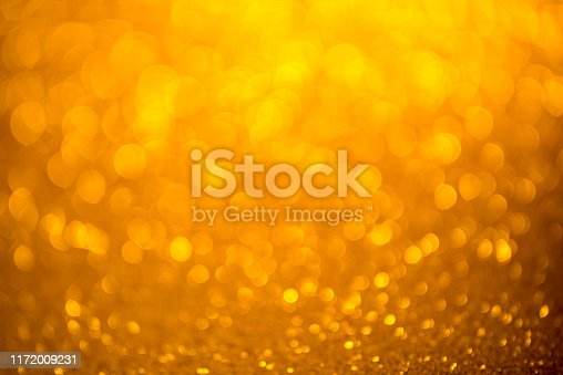 Gold glitter christmas abstract background. Defocused sequin light.