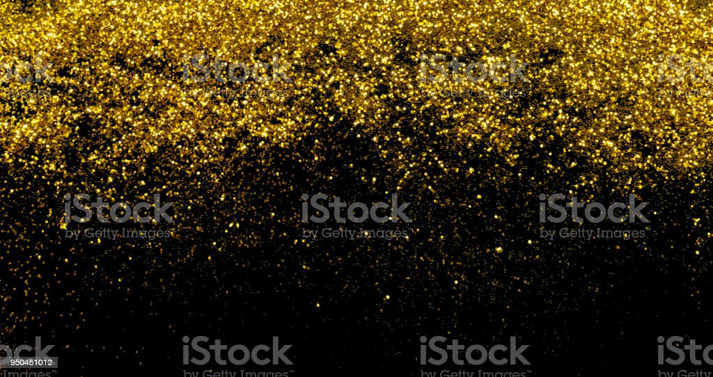 Gold glitter isolated on black background stock photo