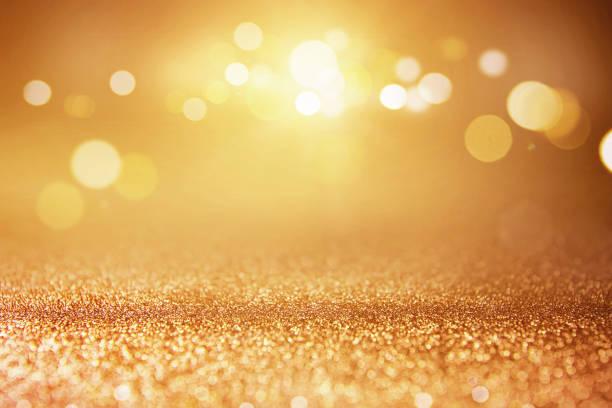ゴールドのキラキラ ライト背景のボケ味。 ストックフォト