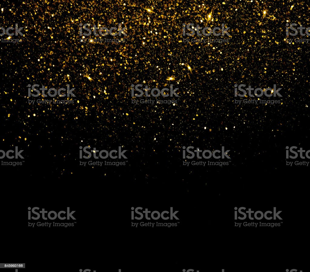 Fond de particules de paillettes d'or - Photo