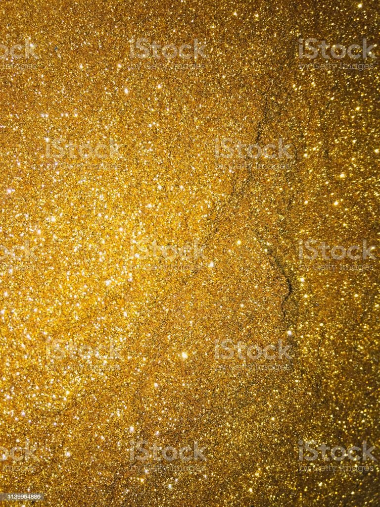 Christmas abstract background gold glitter sparkle and texture
