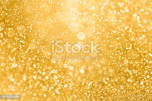 istock Gold Glitter Sparkle Background for Christmas, Wedding Anniversary or Birthday 874231556