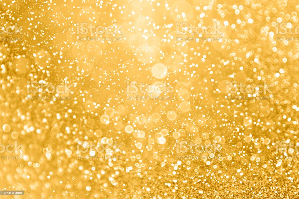 Gold Glitter Sparkle Background for Christmas, Wedding Anniversary or Birthday stock photo