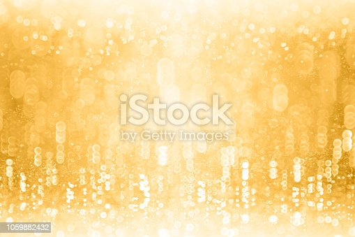 istock Gold Glitter Sparkling Background for New Year Eve Champagne Bubbles or Birthday Anniversary 1059882432