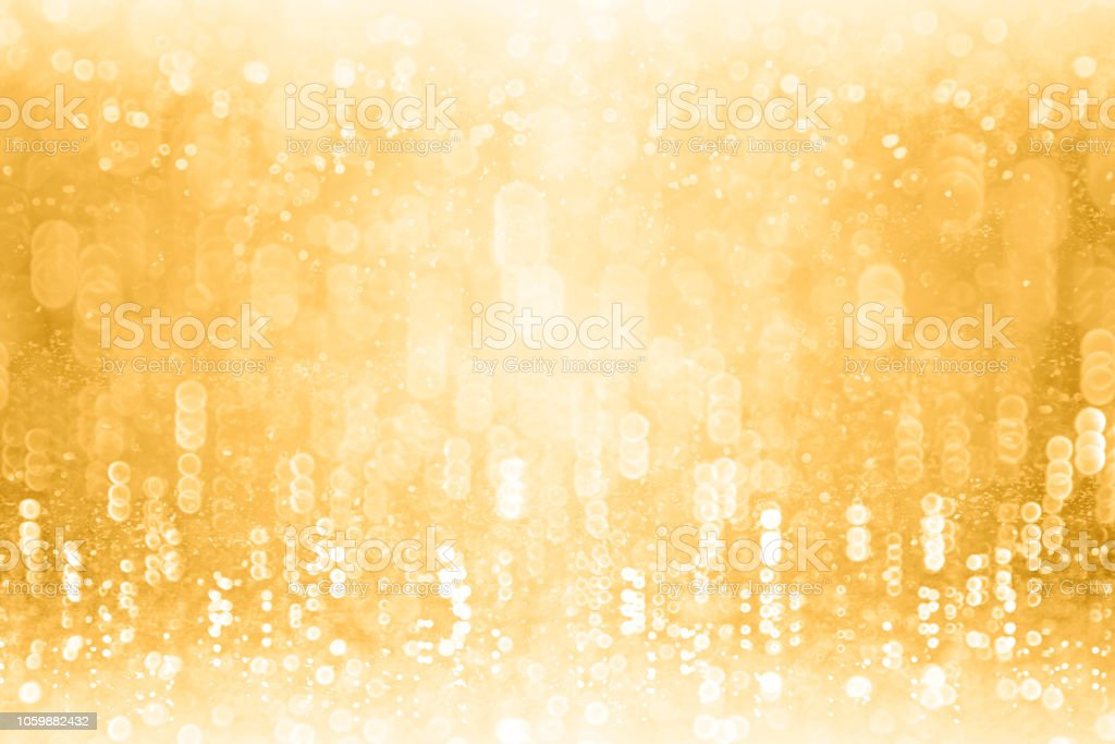 Gold Glitter Sparkling Background for New Year Eve Champagne Bubbles or Birthday Anniversary stock photo