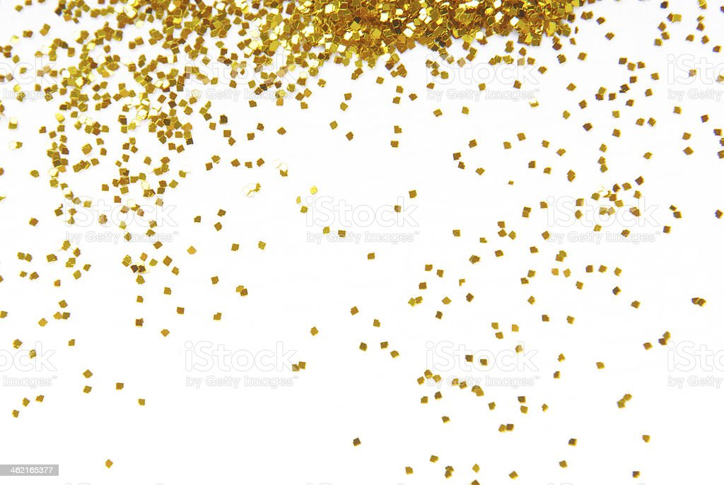 Gold glitter sprinkles down from top of frame