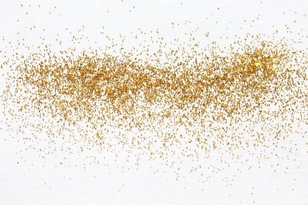 Gold glitter sprinkles stock photo