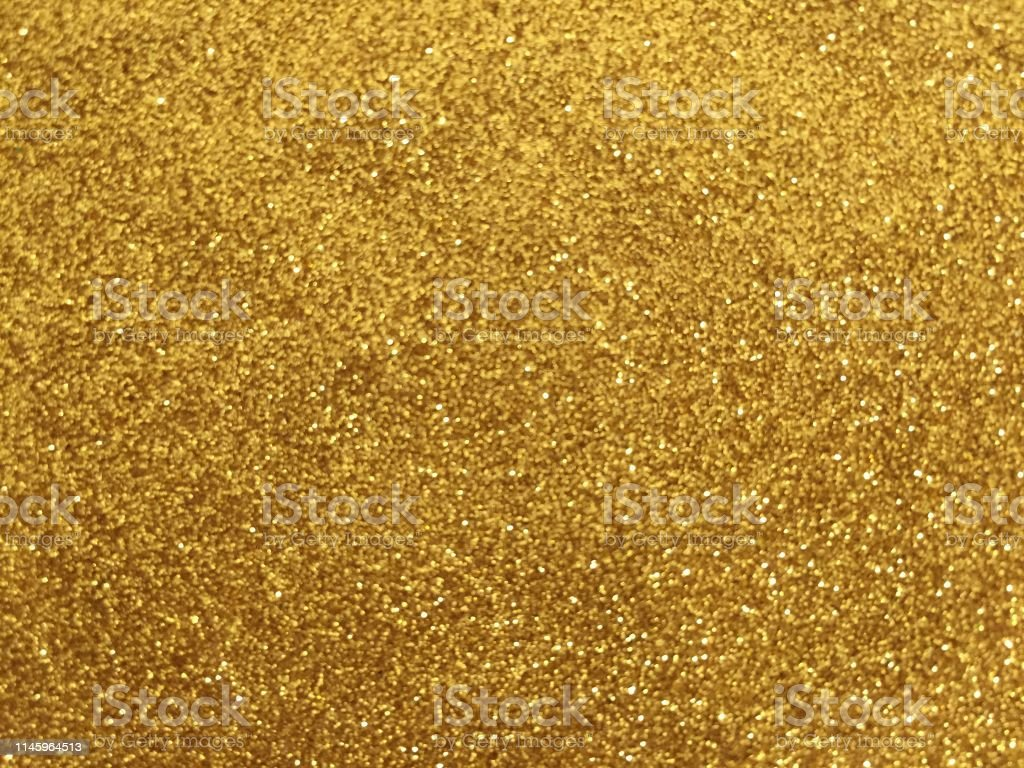 Christmas abstract background of gold glitter texture