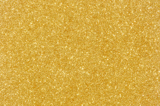 gold glitter texture abstract background - scintillante foto e immagini stock