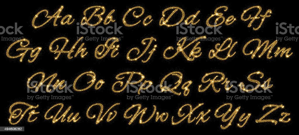 Gold glittering alphabet of stars dust trail stock photo