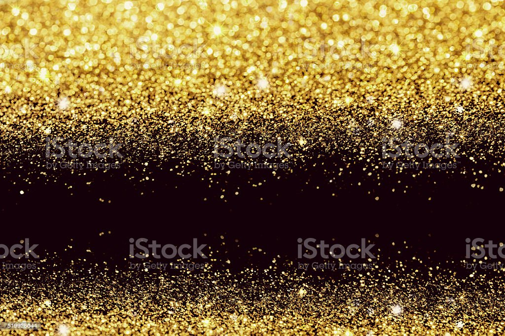 Gold glittering bokeh abstract background stock photo