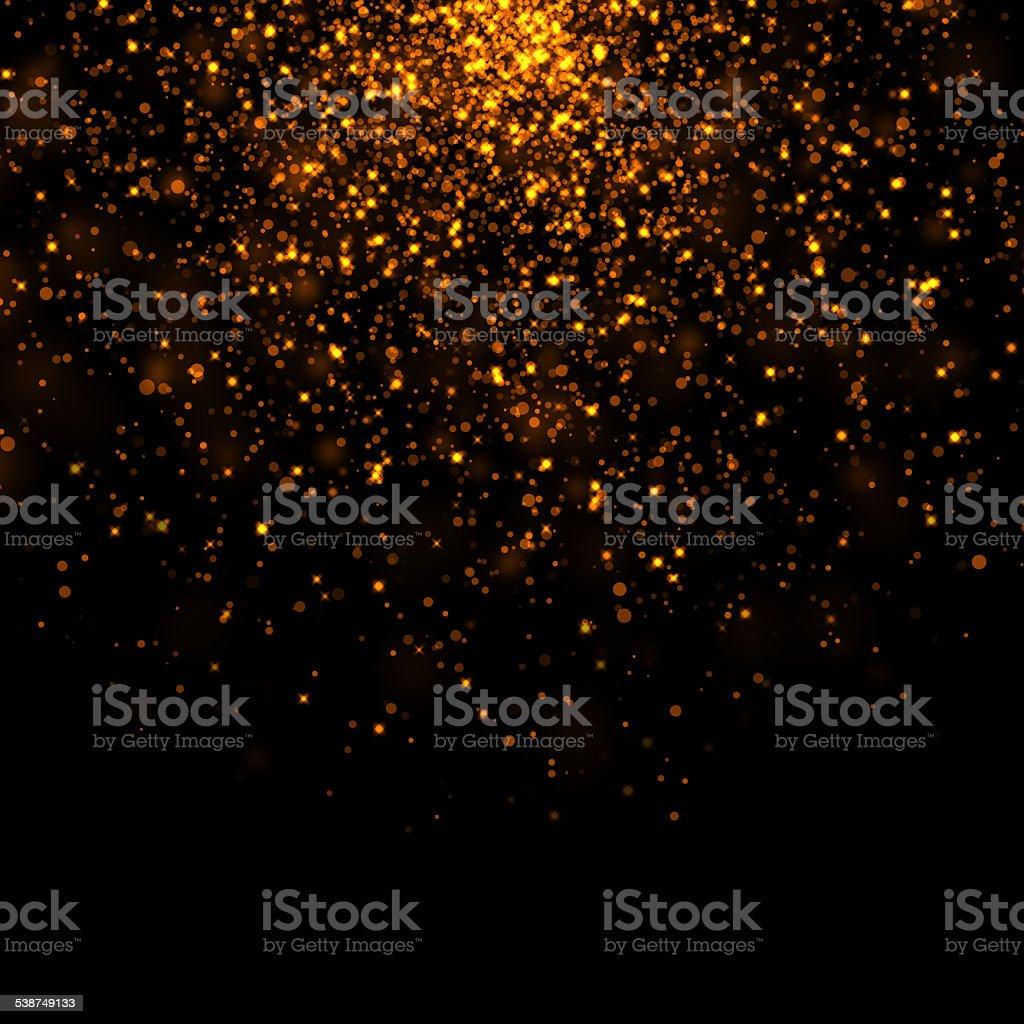 gold glittering bokeh stars tail dust stock photo