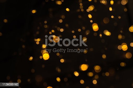 Gold glittering star light and bokeh. Abstract background.