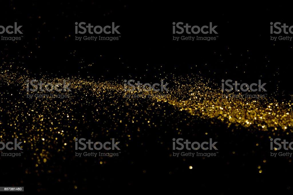 Gold glittering star light and bokeh. - foto stock