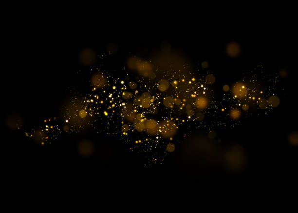 gold glittering star light and bokeh.magic dust abstract background element for your product. - rozjarzony zdjęcia i obrazy z banku zdjęć