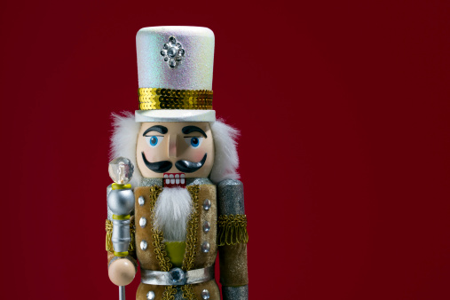Gold Glittery Nutcracker with Red Background