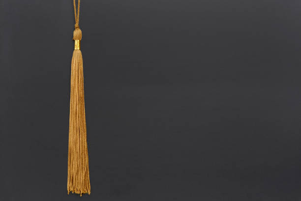 gold graduation tassel honors gold graduation tassel on blackboard background school concept tassel stock pictures, royalty-free photos & images