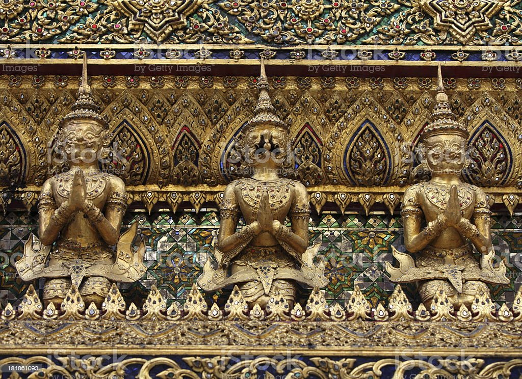 Gold Guardians of Wat Phra Kaeo Bangkok Thailand royalty-free stock photo