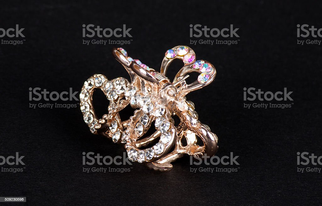 Gold hair clip with decorative stones stock photo