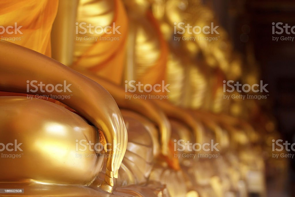 gold hand Buddha statue sit royalty-free stock photo