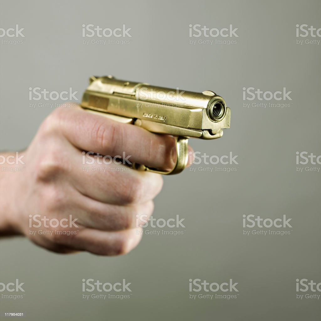 Gold handgun royalty-free stock photo