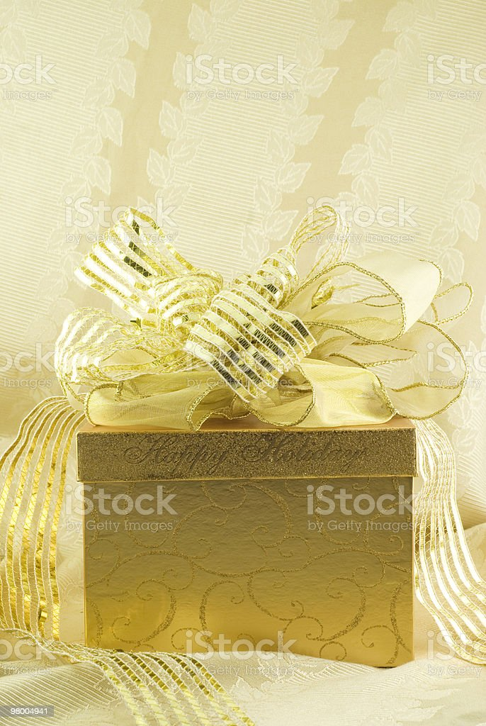 Gold Happy Holidays Gift Box with Bow royalty-free stock photo