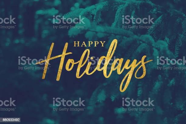 Gold happy holidays script with evergreen background picture id880933492?b=1&k=6&m=880933492&s=612x612&h=npomljlmlrgznu qlrnazpoarcc8l00win0ooo96bik=