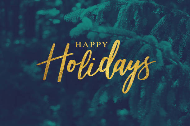 gold happy holidays script with evergreen background - christmas green stock photos and pictures