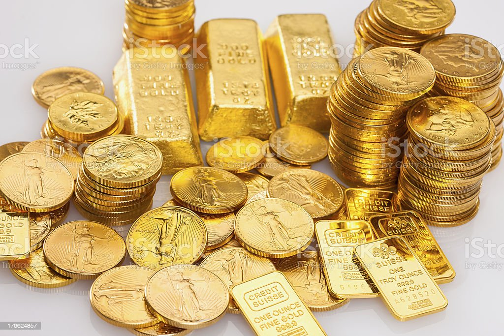 Gold Ingot and Coins royalty-free stock photo