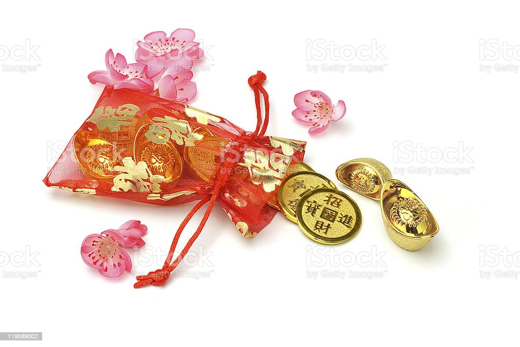 Gold ingots and coins in red sachet royalty-free stock photo
