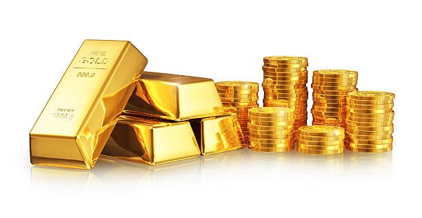 ingots e moedas de ouro - foto de acervo